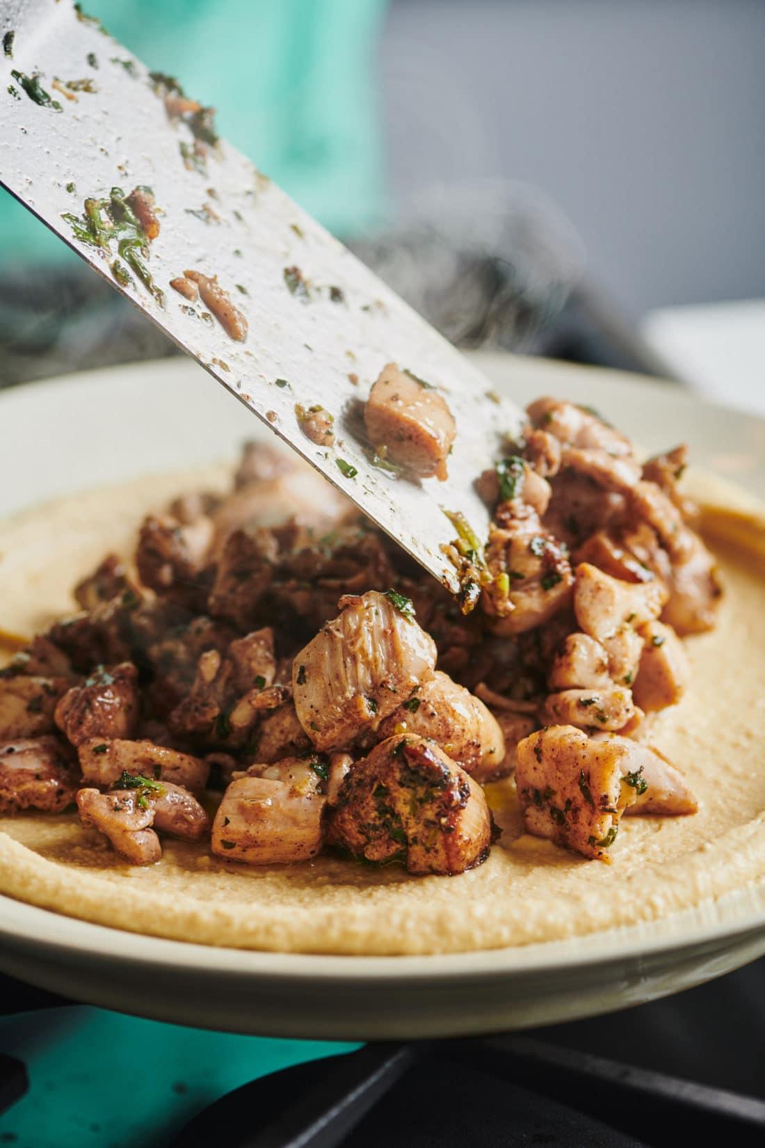 Chicken Kawarma with Lemon Sauce over Hummus