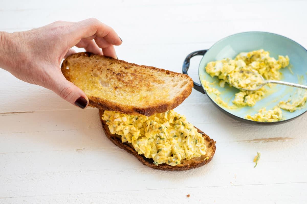 making an egg salad sandwich