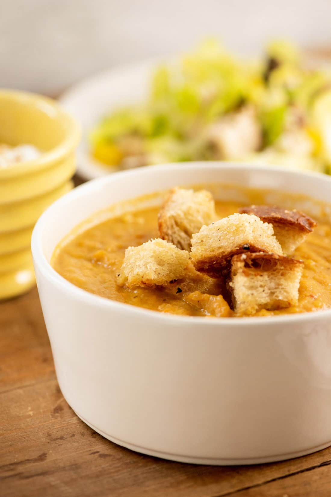 Closeup of Spicy Roasted Root Vegetable Soup with Parmesan Croutons
