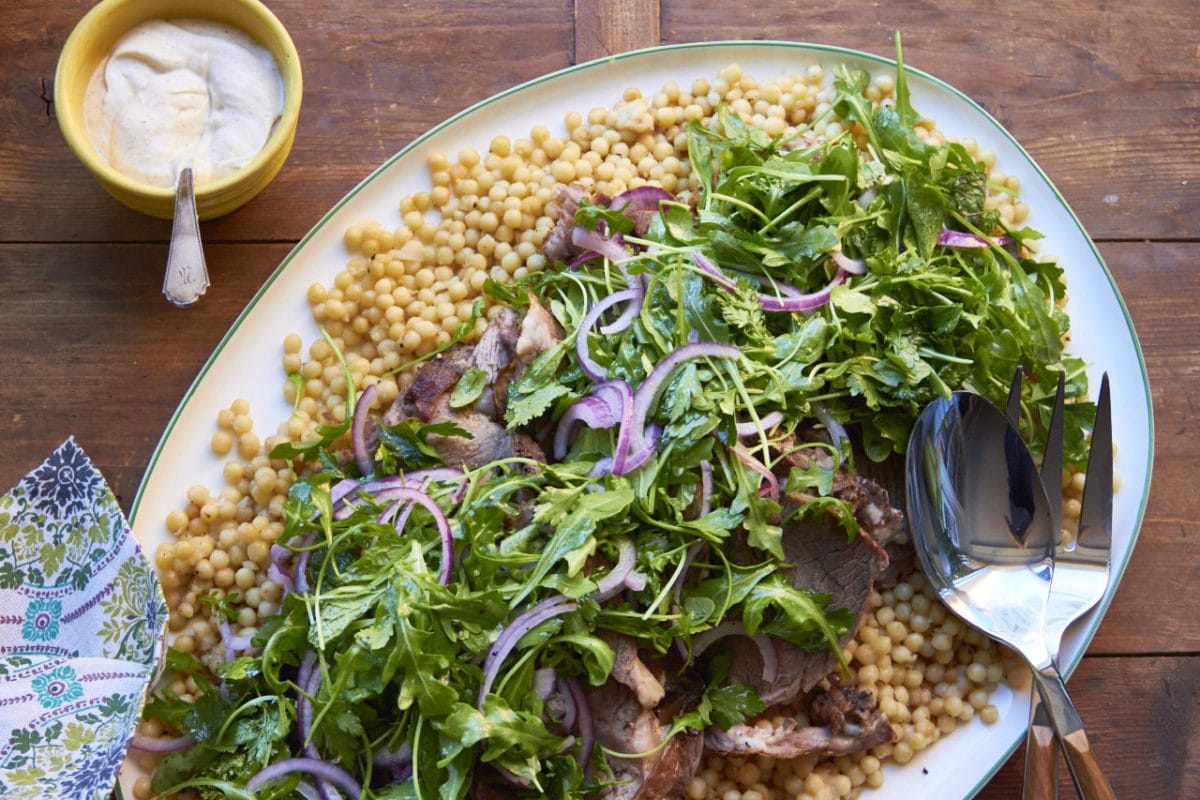 Slow Cooked Herbed Leg of Lamb with Fresh Herb and Arugula Salad