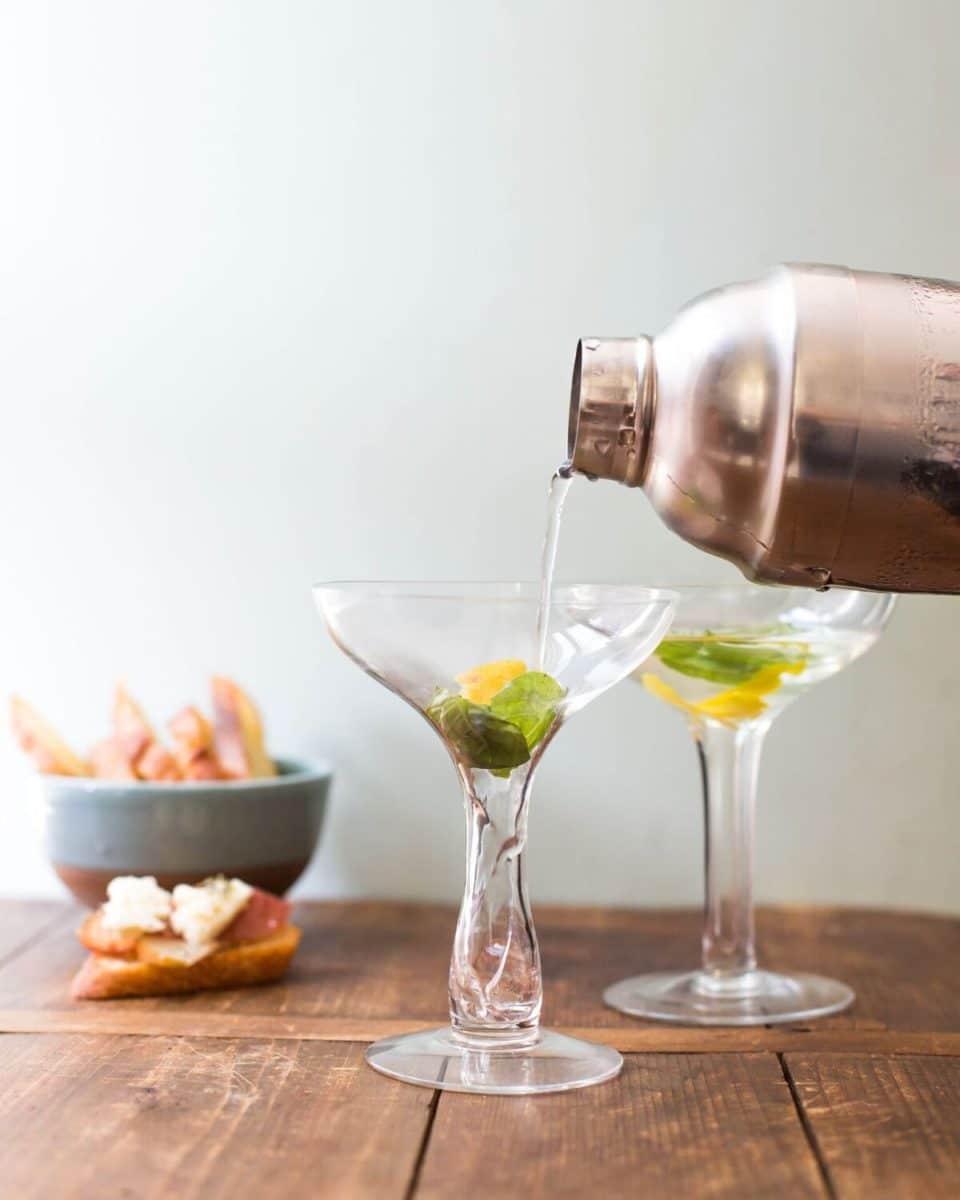 pouring a sake cocktail
