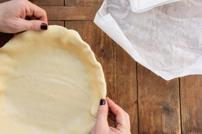 Fitting pie crust into the pan