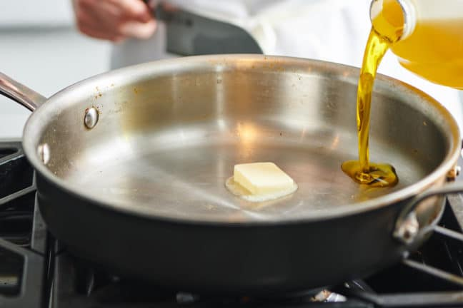 Heat up oil and butter in a pan