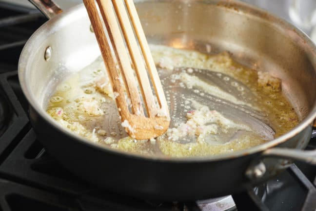 Add garlic to the pan and saute
