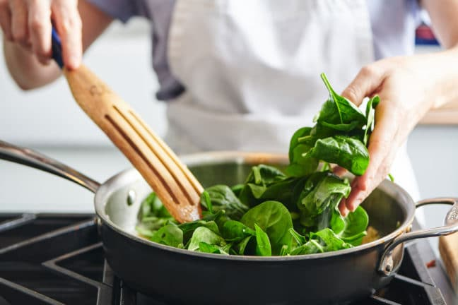 Add spinach to the pan in batches
