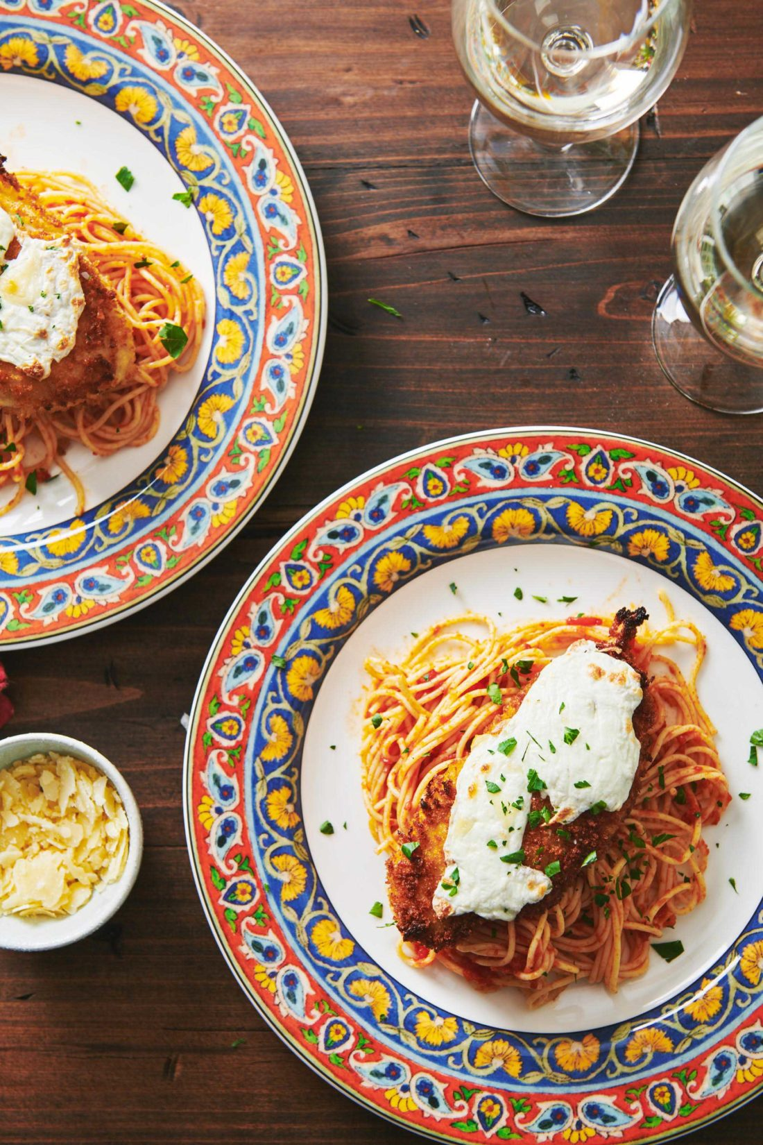 two plates of Chicken Parmigiana
