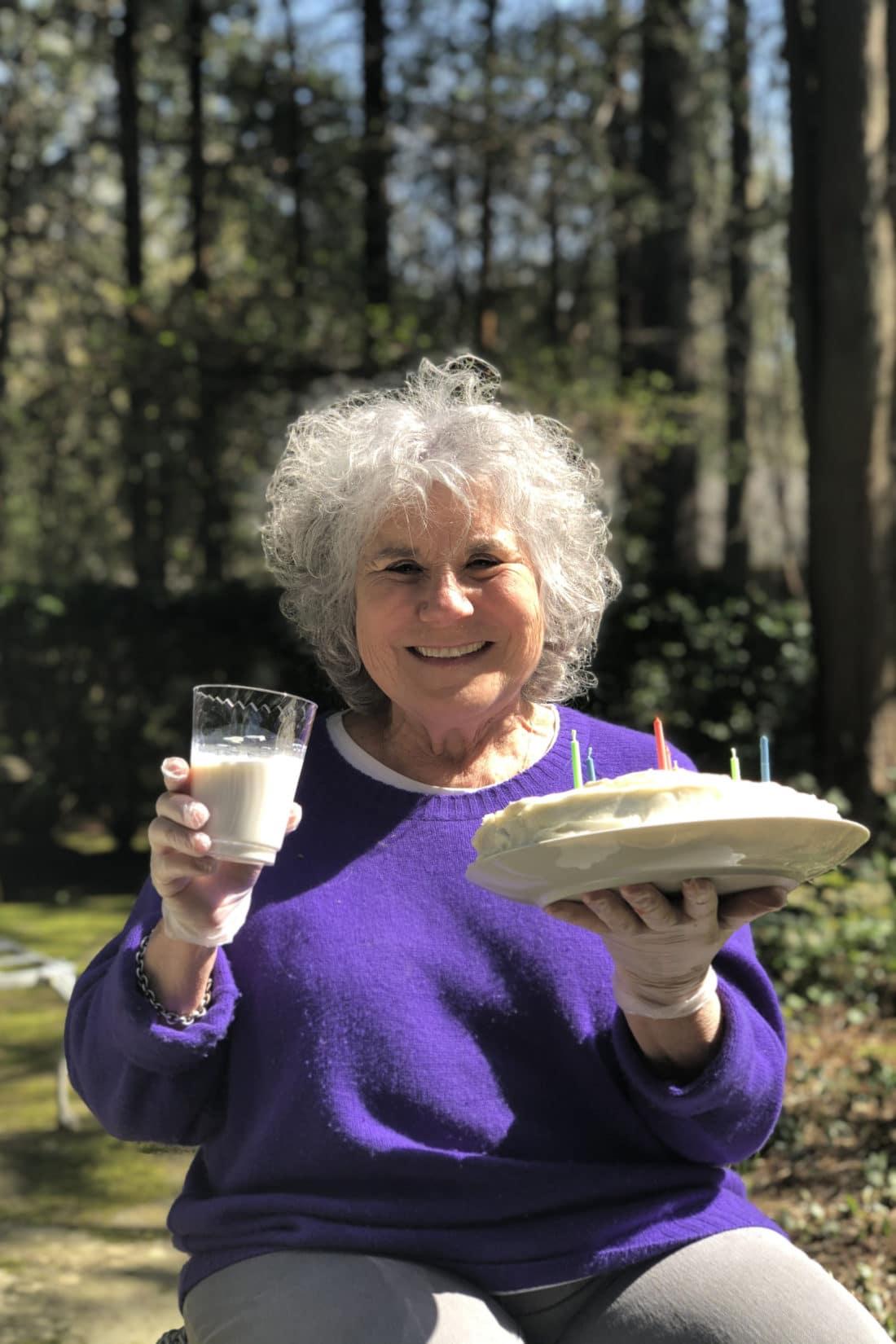 Mom holding up a slice of banana cake