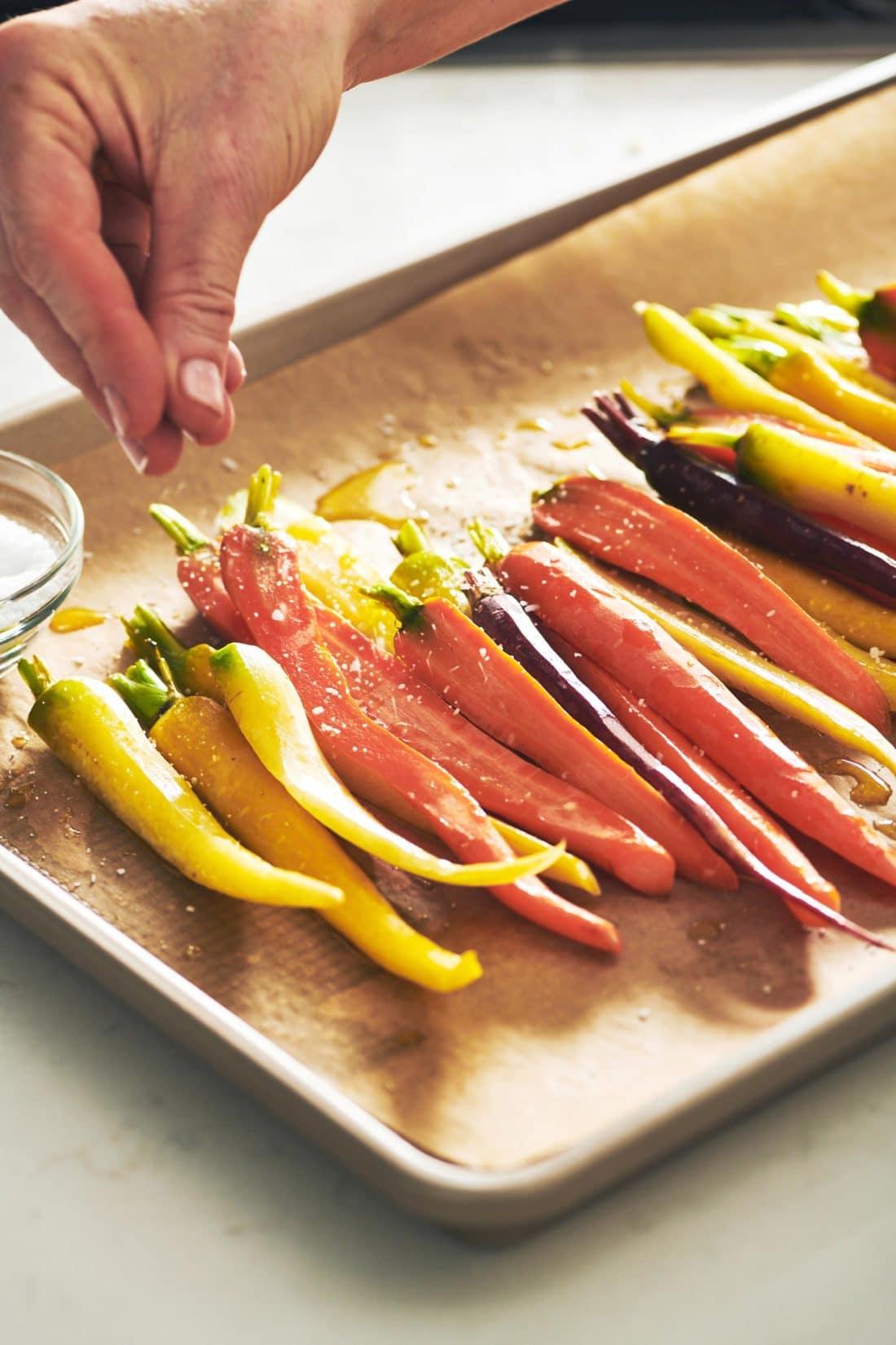 Sprinkling salt on carrots